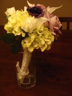 Make your wedding bouquet last forever! Put together fake flowers to recreate your bouquet =)