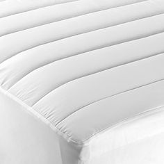 A comfortable and lofty mattress pad can make all the difference for a great night's sleep. This luxurious Laura Ashley Mattress Pad provides extra comfort and is hypoallergenic for allergy sufferers.