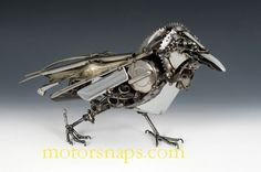 Beautiful raven made of motor parts. Sculptor is James Corbett    http://www.motorsnaps.com/key/sculpture?g2_itemId=55089