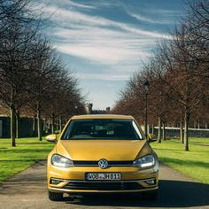 This photo of the Volkswagen Golf shows the beautiful side of autumn. Blue skies and lines of trees framing the car.