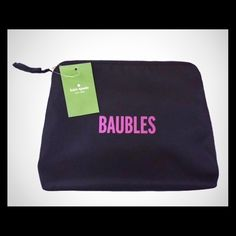 Kate Spade BAUBLES larger Pouch /Clutch /multi bag Kate Spade 'Baubles'  multi-bag for clutch wear or Jewelry /Cosmetic /Accessory Storage! by Kate Spade of New York! Details ; Black Kate Spade New York Single interior pocket and zip closure top.  Black bag, pink interior lining.  Great for travel and very pretty on your counter at home! This is a must-have if you love Kate spade! This is also part of her bon voyage collection! Approximate measurements are 10 x 11 x 3 .5–4 inches! I ship…