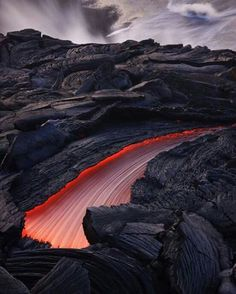 A narrowing river of lava flows through the fractured surface of the delta feeding the ocean entry and creating new land. Big Island, Hawaii. Photo By @bruceomori