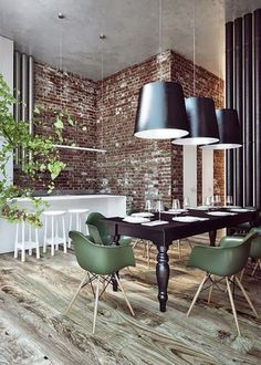 Eclectic dining room : classic table, mid-century modern chairs, design XL pendants, Red bricks wall