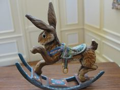 Amanda Skinner - Rabbit Rocking Toy, rabbit is hand painted metal, rockers are painted wood; sold on ebay for $332.78