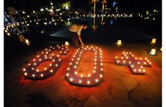 A Balinese lights a candle during an Earth Hour event at a hotel in Nusa dua on the resort island of Bali on March 23, 2013.