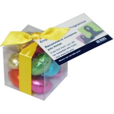 Easter Egg Cubes. Acetate cubes containing 50g of foiled mini eggs. Box is ribbon tied and branded with a CMYK printed tag.