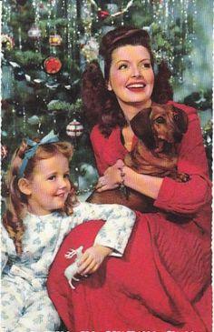 Vintage Christmas postcard featuring a dachshund