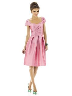 Cocktail length dupioni dress w/ draped  bodice and slight sweetheart neckline. Pleated cap sleeves. Full pleated skirt w/ pockets at side seams. Dress available full length as style D575.  Sizes available: 00-30W, and 00-30W extra length.  http://www.dessy.com/dresses/bridesmaid/D574/