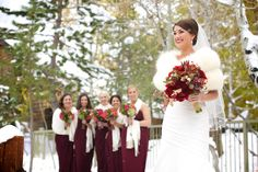 Winter wedding bridal party in snow