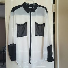 Black and White Contrast Top Beautiful sheer white button down shirt with black accents (pockets, quarter of sleeves, collar pockets, and top back of shirt) worn once. Black piping down the middle hides buttons so they wont be seen. Bisou Bisou Tops