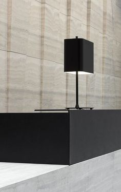 171 Collins Street, Melbourne By Bates Smart. Monolithic limestone walls and desk with black steel accents and custom lighting. Looking for an overall neutral palette with shocks of focus: