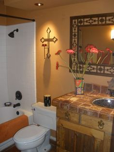 Cross... maybe on an accent wall?       Southwest guest bathroom incorporates Onyx tile, copper and mosaic sink: