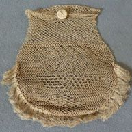 Historic detail:  Small coconut fibre purse, worn with string ties at wrist, or buttoned to waist.  Early 19thC.
