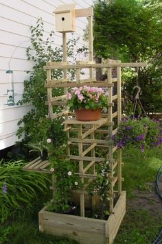 How to Build a Vertical Garden ~ raised bed with trellis, shelves, and hanging area ~ written instructions with just the above pic as guide, and reference link @ familyhandyman is gone