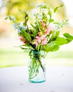 These simple centerpieces are easy to create on your own making each flower arrangement a great option for a low-key wedding reception, bridal shower, or spring celebration. Green Wedding Centerpieces, Bridal Shower Centerpieces, Simple Centerpieces, Wedding Decorations, Wedding Ideas, Centerpiece Ideas, Table Wedding, August Centerpieces, Diy Wedding