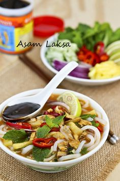 Asam Laksa is a flavorful, tangy, and spicy Malaysian fish based rice noodle soup. It is a dish not to be missed when visiting Malaysia. #malaysianfood #noodles #laksa