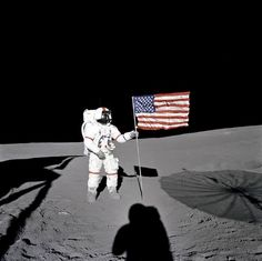 Astronaut Alan B. Shepard Jr., Apollo 14 Commander, stands by the U.S. flag on the lunar Fra Mauro Highlands during the early moments of the first extravehicular activity (EVA-1) of the mission on Feb. 5, 1971