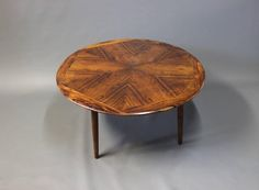 Large Round Coffee Table in Rosewood by Henry W. Klein and Bramin, 1960s | From a unique collection of antique and modern coffee and cocktail tables at https://www.1stdibs.com/furniture/tables/coffee-tables-cocktail-tables/