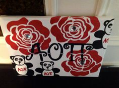 Alpha Omicron Pi Greek Sorority hand painted canvas sign, wall hanging, letters.  This is the perfect gift for RUSH, big sis, lil sis, dorm, apt., gift, or just for yourself.  Greek Licensed.