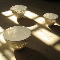 """Eeva Jokinen """"Rice grain porcelain is an old ceramic method. The wall of an object is first pierced through with a sharp tool. After the biscuit firing the hole is filled with glaze which melts into the hole in the later firing creating a small translucent window."""""""