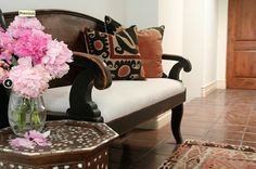 dark distressed wood with warm cushions and neutrals