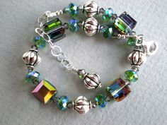 Green crystal bracelet - Swarovski crystals bracelet, silver & cube beads bracelet, sterling silver chain adjustable to 9 inchs wire strung by IvoryCatCreations on Etsy https://www.etsy.com/listing/189831447/green-crystal-bracelet-swarovski