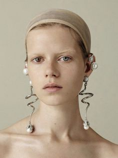 Earrings by Balenciaga A/W 2015/16. Kadri Vahersalu photographed by Ben Toms for AnOther Magazine.