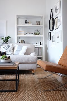 neutral palette, love the coffee table & rug // via Danielle Moss