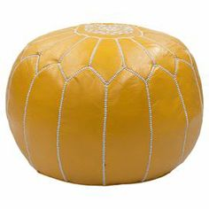 """Brimming with exotic appeal, this handcrafted leather pouf showcases embroidered Moroccan-inspired detailing.  Product: OttomanConstruction Material: Wood and leatherColor: YellowFeatures: HandmadeDimensions: 14"""" H x 20"""" Diameter"""