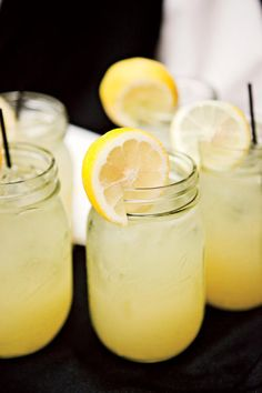 Lynchburg Lemonade - Signature Wedding Drinks - Southernliving. Highlight local products like Lynchburg Lemonade in mason jars with a lemon slice garnish. from the wedding of Anna Krueger and Joe Thomas