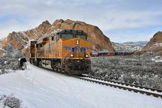 A southbound Union Pacific train through the Snow at Mormon Rocks by Dave Toussaint (www.photographersnature.com), via Flickr