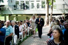 An Orange & Purple Wedding: The Groom's step mother is escorted down the aisle by the Groom's brother. http://linnealizphotography.com