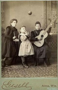 ca.1860-1900 carte de visite portrait of three young ladies One plays the guitar, another looks at the ball suspended in the air.
