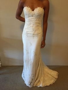 This strapless wedding gown has lace embroidery detail. The fitted design is flattering to the shape. Brides can have elegant wedding gowns custom made to order specific to their personal preferences and style by our firm.  In addition to custom #weddingdresses we also make pretty close #replicas of haute couture designs too.  So if your dream gown is more than you can afford get pricing for a replica when you visit our website at www.dariuscordell.com