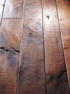 Distressed hardwood floors. i like this size, but lighter color.
