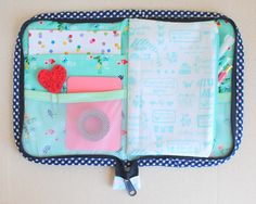 Fabric pockets, mesh pockets and a pencil pouch in this zippered case. Perfect for quilting or crafty projects. The Flora Case