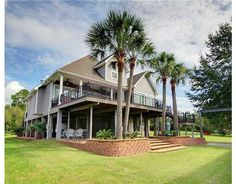 BEAUTIFUL WATERFRONT HOME ON THE BAYOU WITH A BOATHOUSE!  MARBLE FLOORING, CUSTOM MILLWORK, WHITE GLAZED CABINETS WITH BACKSPLASH, GRANITE COUNTERTOPS, FORMAL LIVING AND DINING ROOMS, OPEN FLOOR PLAN WITH WATER VIEWS, MASTER BEDROOM HAS WATER VIEW AND LARGE WALK-IN CLOSET. WALK TO THE TENNIS CLUB!