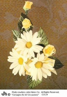 This daisy design has a slight crescent shape to it.  This makes it interesting, with the focal point being the three clusters of daisies in the center.