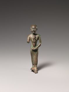 Standing man holding statuette of Nebethetepet or Nehemetaui, 600–200 B.C. Egypt. The Metropolitan Museum of Art, New York. Theodore M. Davis Collection, Bequest of Theodore M. Davis, 1915 (30.8.98)