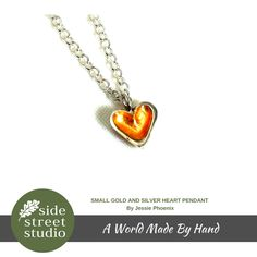 SMALL GOLD AND SILVER HEART PENDANT  Mini Gold Open Heart Necklace - Sterling Silver and 23k gold leaf- Handmade   This lovely sterling silver open heart has a gold leaf finish on the inside. The chain measures 16 inches and the heart 3/10 inches across.  Handcrafted by Jessie Phoenix on Vancouver Island B.C.
