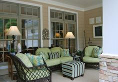 I love this patio furniture. Dark wicker with bright colors.