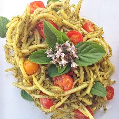 """Sweet Potato """"Pasta"""" (spiralizer) with a heavy metal detox pesto and fresh #garden tomatoes & basil. Still perfecting the detox pesto #recipe #development. Nutrition You Can Trust:  #organic #nongmo #sustainable #realfood"""