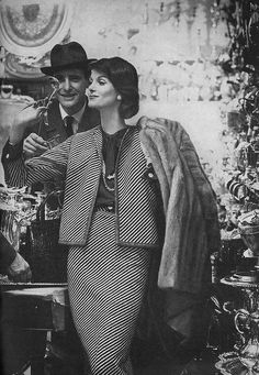 January Vogue 1959    Wearing a black and white wool tweed suit worn with a navy silk blouse, by Davidow.