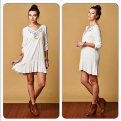 """⭐️SALE!⭐️NWT Boho Embroidered Dress NWT Boho Embroidered Dress. The perfect vacation dress, casual dress, or one to wear out! Embroidery detailed neckline, with an unfinished hem. Elasticized 3/4 length sleeves, and ruffle at bottom hem. Back hem 2"""" longer than front. Keyhole button closure. 100% Rayon. Available in Small (0-4) or Medium (6-8) Front Length (add 2"""" to back length) S 32"""", M 33""""🚫No Trades and No Paypal🚫Sold out of Larges Dresses"""