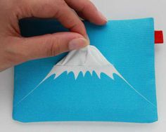Mt. Fuji Travel Tissue Case Blows Its Top When You Blow Your Nose