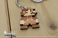 Laser cut and engraved Mario Bros 8bit wood keyring. By TwikiConcept on Etsy