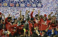 The Chile squad celebrate with the Copa America trophy after finally winning the tournamen...
