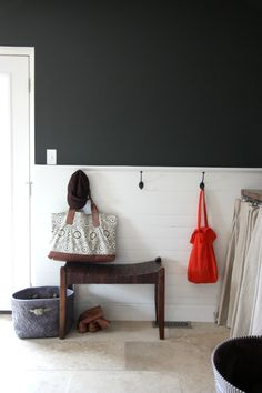 Mudroom idea with Subway tiles, maybe some chalkboard paint above
