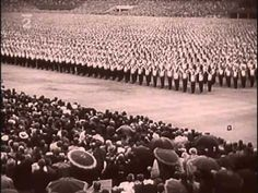 The Strahov Stadium in Prague in the summer of 1938l. There was heightened tension as it was prior to the impending invasion by Nazi Germany. The festival was programmed for the defense of the fatherland.