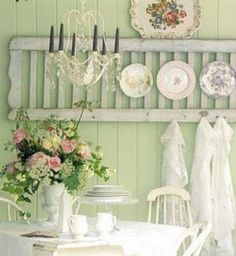 Good use of an old ladder or shudder.....hang plates, etc. and hooks on bottom for aprons, etc. And the top is even a shelf for platters, etc!